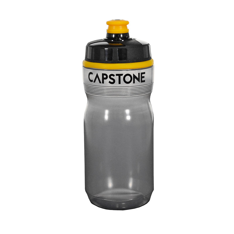 Capstone Sports - 20 oz clear, grey tinted water bottle - Top of the bottle is lined with a thick yellow stripe around - Top of mouthpiece is yellow