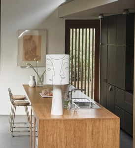 kitchen island with table lamp with faces