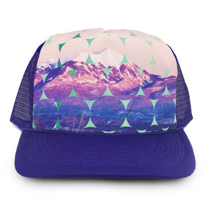 trucker hat with purple cap and fabric with image of moab mountain