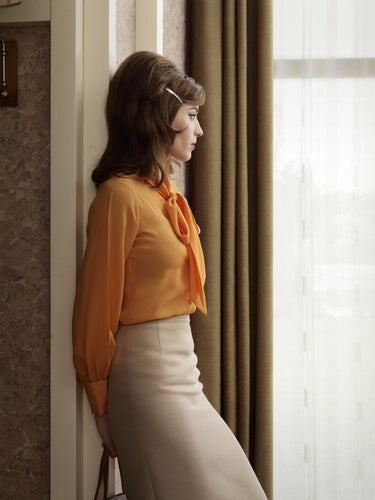 erwin olaf grief sseries portrait of caroline, woman with orange blouse