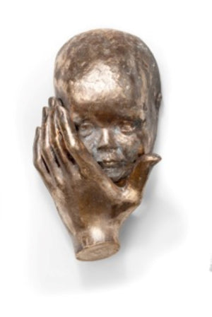 3d sculpture in bronze of hand that holds the prescious face of a baby