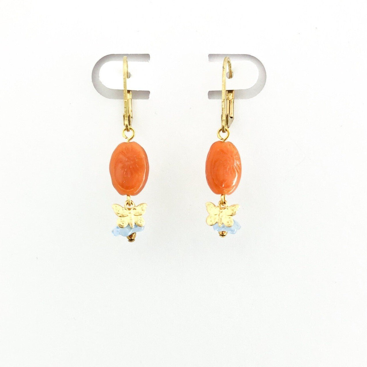 orange stone earrings with brass butterfly and blue flower