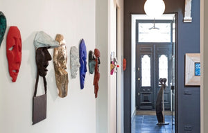 interior view with art works and row of sculptures in bronze by renee van leusden