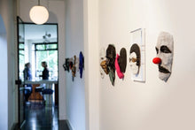 Load image into Gallery viewer, house of an art collector with a row of 3d bronze sculptures made by renee van leusden