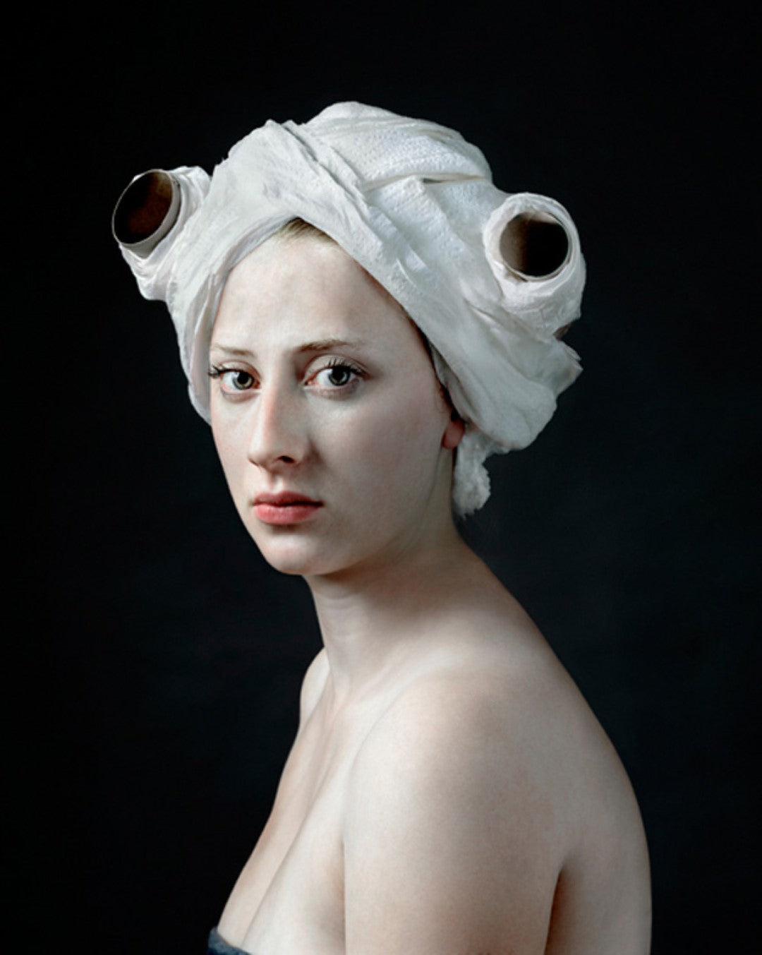 paper roll by hendrik kerstens woman with toilet paper on her head