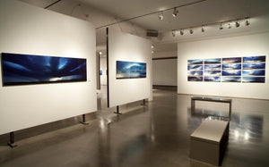 overview shot of museum style presentation supercell photo's in gallery