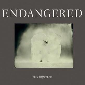 hardcover art coffee table book about endangered animals by Erik Hijweege