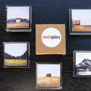 selection of small art gifts in claer boxes