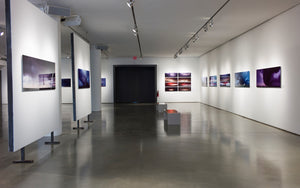 overview of a gallery exhibition of pictures of thunderstorms and supercells
