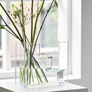glass staircase vase inspired by dutch painter piet mondriaan with green branches