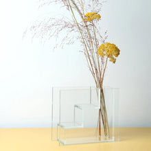 Load image into Gallery viewer, glass staircase vase inspired by dutch painter piet mondriaan with yellow flowers