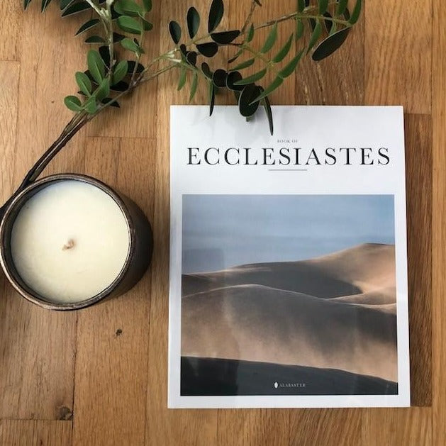 Bible book Ecclesiastes with HKliving USA candle and leafs
