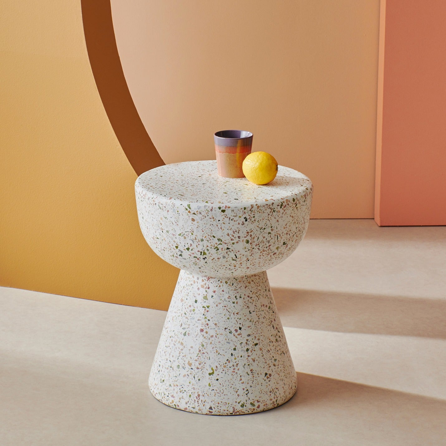 small diabolic shaped terrazzo table