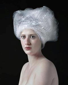 hendrik kerstens bubble wrap woman with bubble wrap on her head