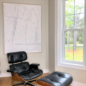 Eames chair and large white framed painting