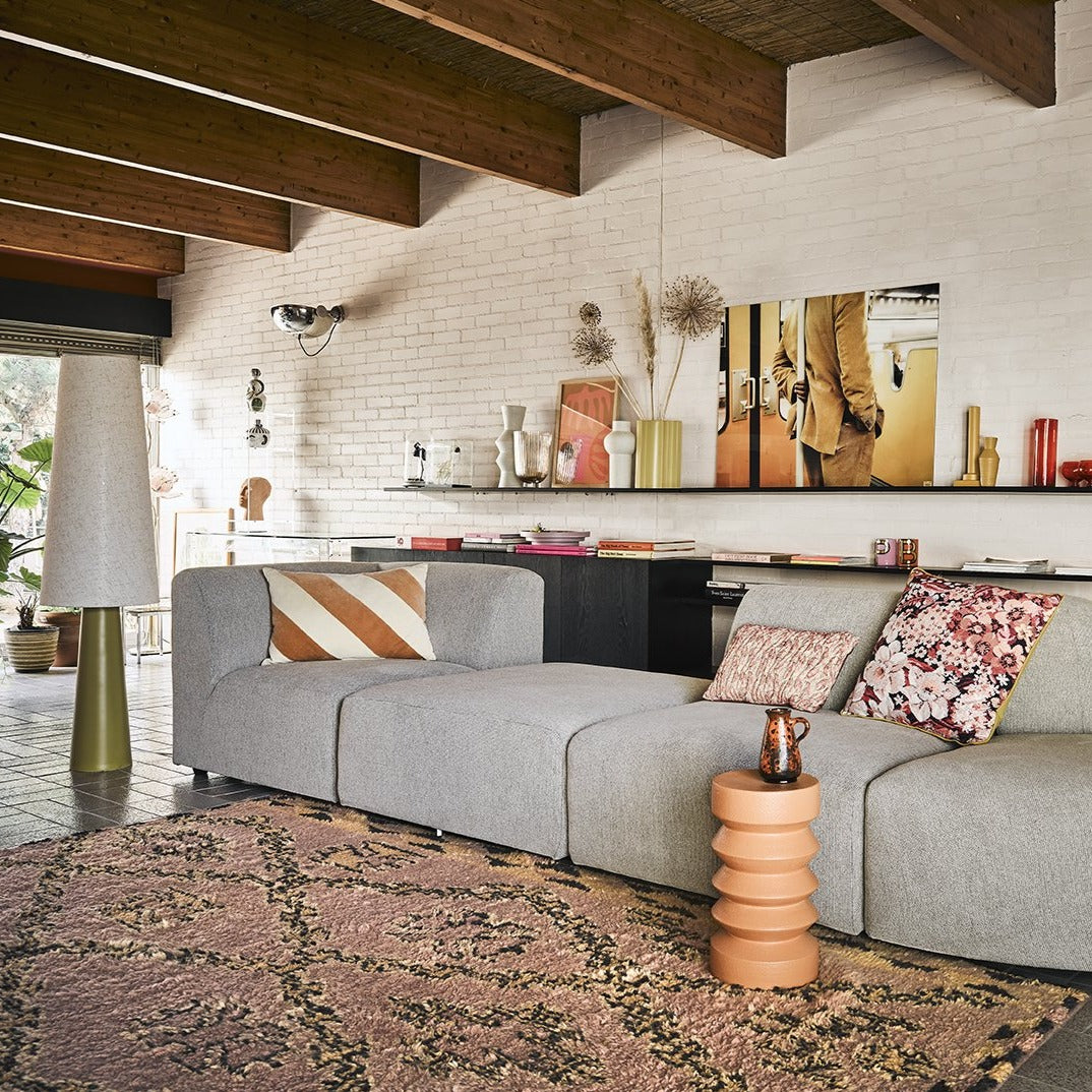 midcentury modern living room with stoneware accent table in terracotta color