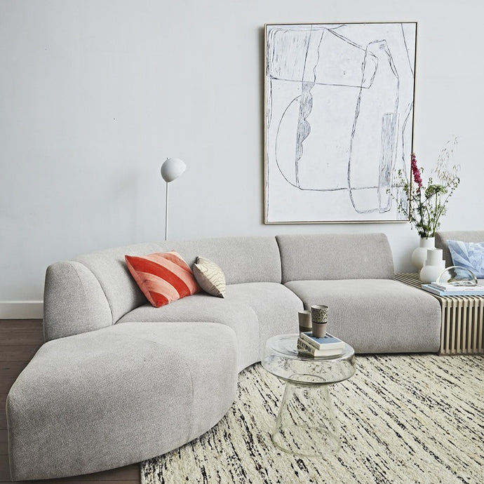 mid century modern living room with large white canvas painting
