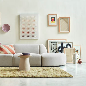 modern living room with pastel colored art and objects