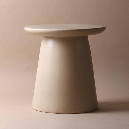 earthenware accent table in neutral color