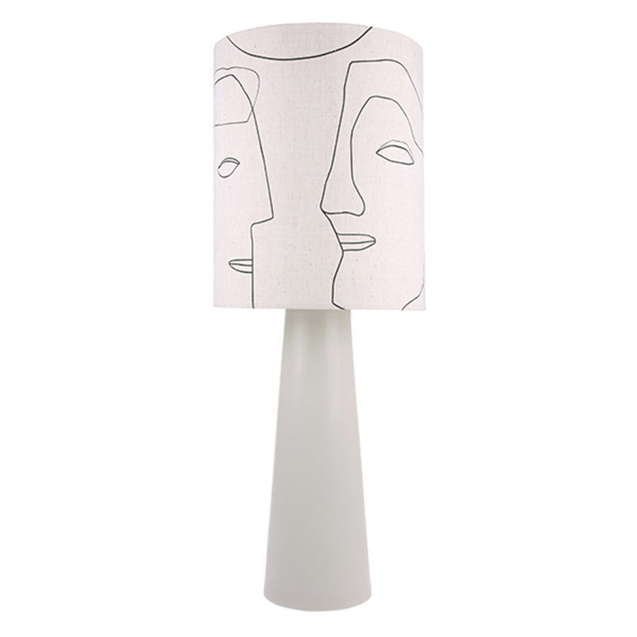 table lamp with faces on it and a grey base