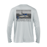 a back design of a bright blue, yellow and white marlin, in front of a black and white picture of a boat off shore fishing on a white 40 UV protective long sleeve performance shirt.