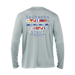 "A silver performance shirt with 40 UV protection. The maritime flag design has ""Southern"" at the top, with a row of different maritime flags underneath. Below the first row of flags are the silhouettes of a tuna, marlin, mahi, and sailfish and another row of maritime flags underneath the silhouettes. Lastly ""Strut"" is under the last row of flags."