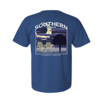 Printed on a Comfort Color flo blue colored t-shirt the night beach design is a night scene with a large crescent moon to the left over the ocean. Two beach chairs on the shore and a silhouette of a palmetto tree to the right.