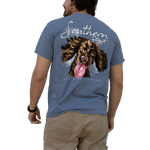 Printed on a Comfort Color washed denim colored t-shirt the rolling stone design is a hand drawn brown boykin puppy, coming in fast with its tongue hanging out ready to lick.