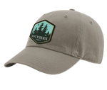 "A driftwood Southern Strut original hat with a hexagon patch with a pine forrest design and at the bottom ""Southern Sturt"""