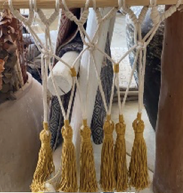 MACRAME WITH YELLOM POMPONS