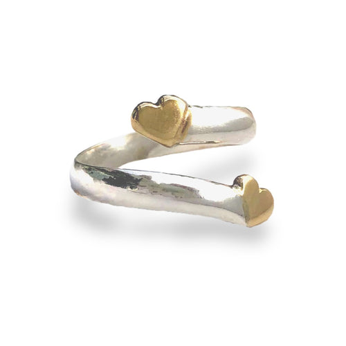 Solid silver twist ring with two gold hearts