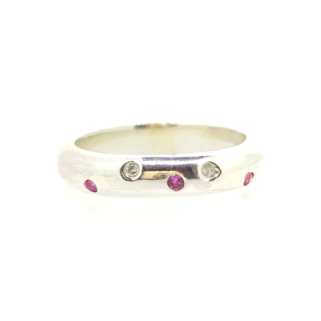 Pink sapphire and diamond scattered ring