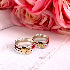 Two hearts beat as one. Her and her wedding rings