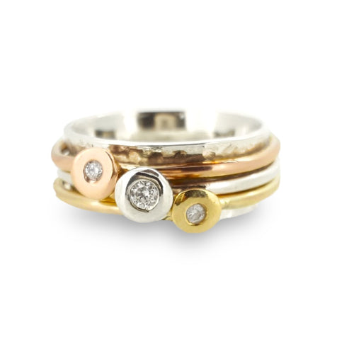 'Scrumdiddlyumptious' - gold rings set with diamonds.