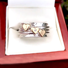Load image into Gallery viewer, Spinning ring with diamonds set in three gold hearts