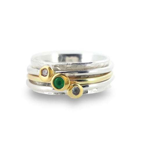 Green with envy - Spinning ring with emerald and diamonds