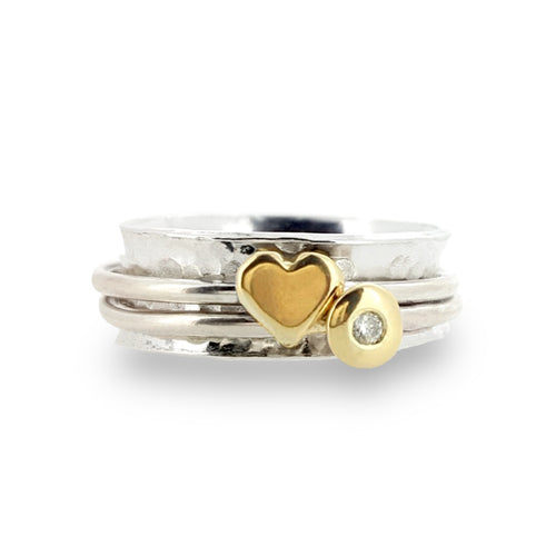'Eternal love'. Solid silver ring set with gold heart and diamond.