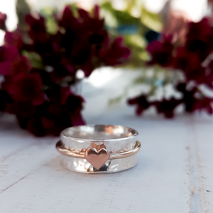 'One Love'. Sterling silver ring with solid gold heart and spinning ring.