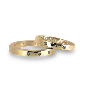 Gold wedding bands with sparkling diamonds