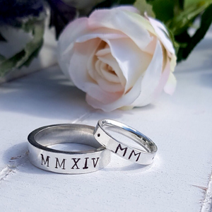 Personalised man's ring with Roman numerals. Sterling silver