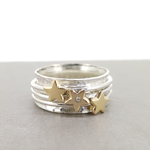 'It's in the stars' - spinning ring with diamonds set in three gold stars
