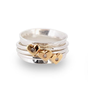 Spinning ring with diamonds set in three gold hearts