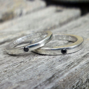 Silver wedding bands set with black diamonds