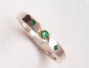 Triple emerald ring with gold bezel setting