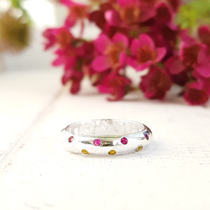 Pink and yellow scattered sapphire ring