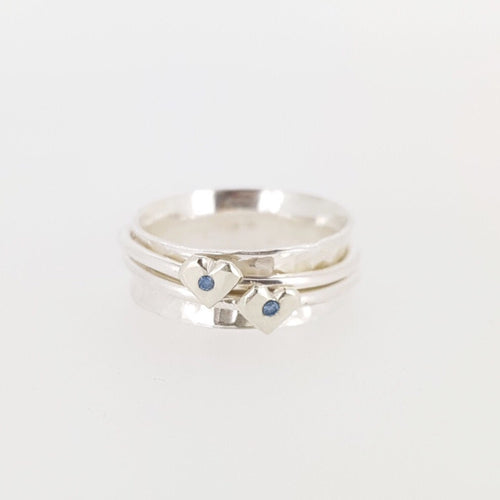 Silver spinning ring with silver hearts and sparkling sapphires