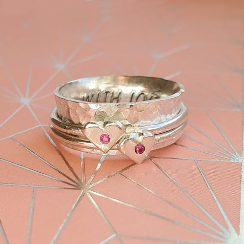 Pink to make the boys wink. Silver spinning ring with silver hearts and sparkling pink sapphires