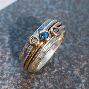 Sea of Tranquillity - Spinning ring with sapphire and diamonds