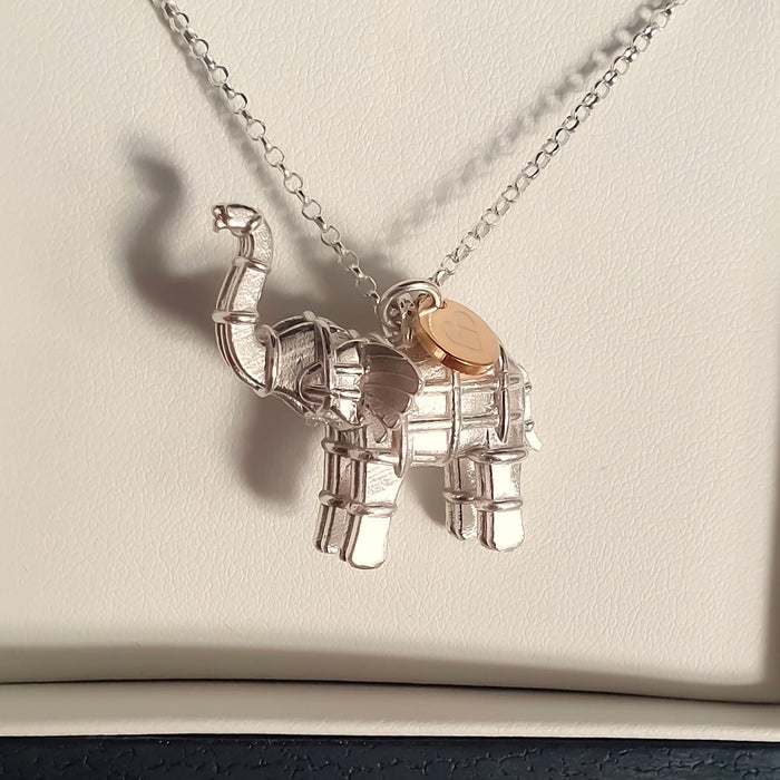 Solid silver elephant necklace with gold heart tag