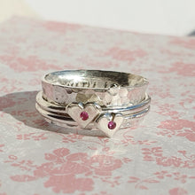 Load image into Gallery viewer, Pink to make the boys wink. Silver spinning ring with silver hearts and sparkling pink sapphires